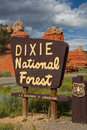 Dixie national forest sign along the road in the background a beautiful red rock formation Stock Images
