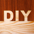 Diy concept in wood two pieces of with the word cutout Royalty Free Stock Photo