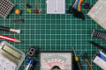 DIY electrical maker tools components on green cutting mat board. Royalty Free Stock Photo