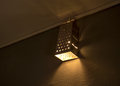 Diy lamp warm lighting coming out from beautiful home made kitchen grater and lamps on wall Royalty Free Stock Images