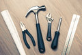 Diy tools against wooden background Royalty Free Stock Images