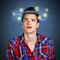Dizzy person seeing stars on blue background Stock Photos