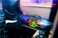 Dj booth a female disc jockey standing in producing music live Stock Image