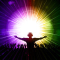 Dj and crowd on purple and green background a glowing party Royalty Free Stock Photo