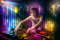 Dj girl playing songs in a disco with light show pretty Royalty Free Stock Photo