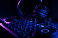 Dj mixer with headphones at nightclub Stock Photo