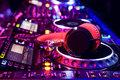 Dj mixer with headphones at nightclub Royalty Free Stock Images