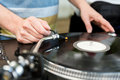 Dj mixes the track in club on vinyl player at party Stock Photo