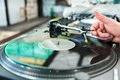Dj mixes the track in club on vinyl player at party soft focus Stock Image