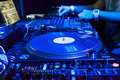Dj mixes the track in the nightclub at party vinyl player foreground Royalty Free Stock Photos