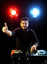 Dj playing music disco electro in a concert hand ok sign Royalty Free Stock Images