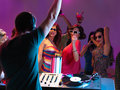 Dj playing music in night club Stock Images