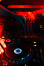 DJ playing music in night club party. Turntable equipment in dar Royalty Free Stock Photo