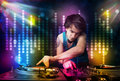 Dj playing songs in a disco with light show young Stock Photos