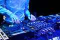 Dj playing the track mixes in nightclub at party headphones Royalty Free Stock Photo