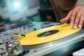 Dj playing vinyl on turntable in nightclub Royalty Free Stock Photos