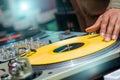 Dj playing vinyl on turntable in nightclub Royalty Free Stock Photos