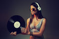Dj portrait woman with vinyl record and headphones Royalty Free Stock Photos
