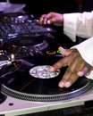DJ scratching on turntables Royalty Free Stock Photo
