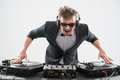 Dj in tuxedo mixing by turntable half length portrait of stylish emotional handsome and sunglasses spinning and music on isolated Royalty Free Stock Images