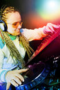 Dj woman playing music by mikser Stock Photos
