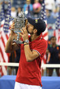 Djokovic winner of us open kisses singles trophy Stock Photos
