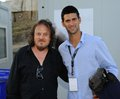 Djokovic zucchero a friendly image of world champion tennis player novak and sugar fornaciari musician Royalty Free Stock Photography
