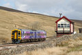 Dmu train at blea moor on settle to carlisle line a morning leeds carlise service passing signalbox the railway the diesel Royalty Free Stock Photography