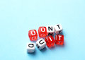 Do it dont quit written on red and white dices on blue background Stock Photo