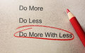 Do more with less circled in red pencil Royalty Free Stock Image