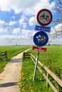 Do not disturb catle sign along a bike trail in holland Royalty Free Stock Photo