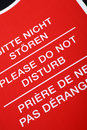 Do not disturb sign written in different languages close up Stock Images