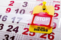 Do not disturb stop sign at weekend concept shot yellow label tag with a road on a paper calendar background Stock Photos