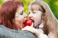 Do not eat my tasty apple it s only mine healthy food with friends outdoor Royalty Free Stock Images