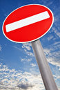 Do not enter traffic sign over white cloudy sky Stock Photos