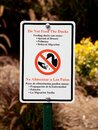 Do not feed the ducks sign at park Royalty Free Stock Photo