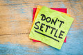 Do not settle reminder motivational advice or on a sticky note Royalty Free Stock Images