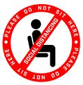 Do Not Sit Here Signage for restaurants and public places inorder to encourage people to practice social distancing to further Royalty Free Stock Photo