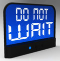 Do Not Wait Clock Shows Urgency For Action Stock Photography
