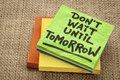 Do not wait until tomorrow advice motivational handwriting on sticky note Stock Image