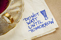Do not wait until tomorrow motivational reminder a napkin doodle with a cup of tea Royalty Free Stock Photo