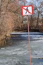 Do not walk sign on frozen river in spring day Royalty Free Stock Photo