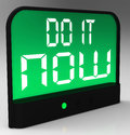 Do it now clock showing urgency for action shows Royalty Free Stock Photography