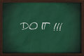 Do it phrase handwritten on a blackboard Royalty Free Stock Photos