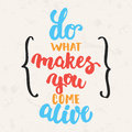 Do what makes you come alive - hand drawn lettering phrase  on the beige grunge background. Fun brush ink Royalty Free Stock Photo