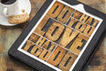 Do what you love motivational word abstract in vintage letterpress wood type on a digital tablet Royalty Free Stock Images