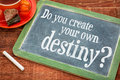 Do you create your own destiny question on a slate blackboard with chalk and cup of tea Stock Image