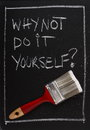 Do it yourself why not written on a used blackboard above a red painting brush as a concept for home decorating and self Royalty Free Stock Photos