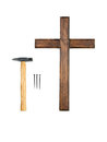 Do it yourself wooden empty cross hammer and three nails crucifying concept Stock Photos