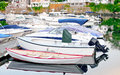 Dock with boats waterfront different Royalty Free Stock Images